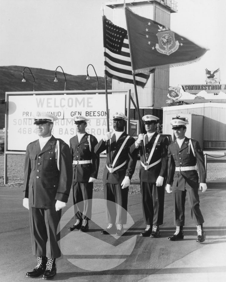 1965 photo of welcome sign at Sondrestrom Air Base, 1965 on the occasion of a visit from Danish Prince Knud.