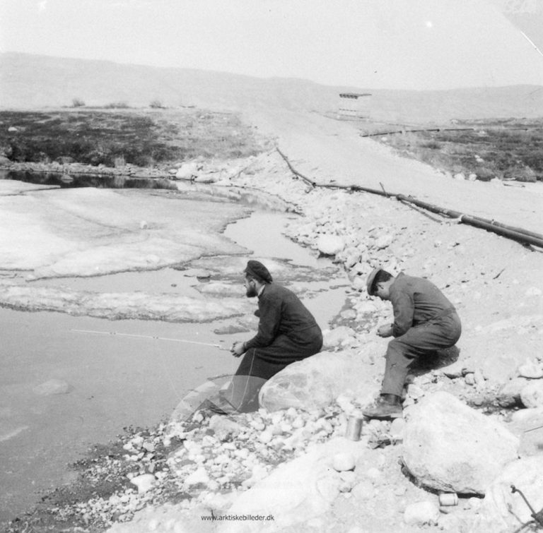 Two men, one with a fishing rod, from the collection of the Danish Arctic Institute